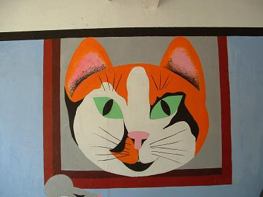 The lovely mural in the cat cage.